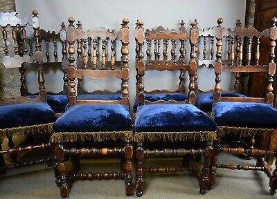 Eight Antique Spanish Spindle Back Dining Chairs with blue velvet seats