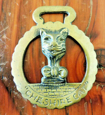 Horse-brass or plaque, Cheshire Cat motif, bottle opener