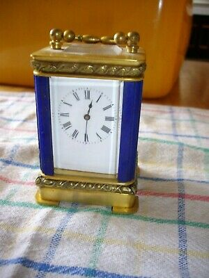 Miniature brass 8 day carriage clock with lapis lazuli uprights.W/Order.NOT Repr