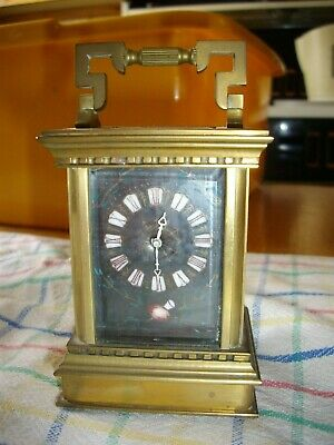 Miniature 8 day Carriage clock with enamelled dial and side panels.W/Order.