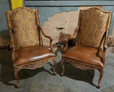 Pair of Classic Arm Chairs Detailed with Wood Leather and decorative fabric