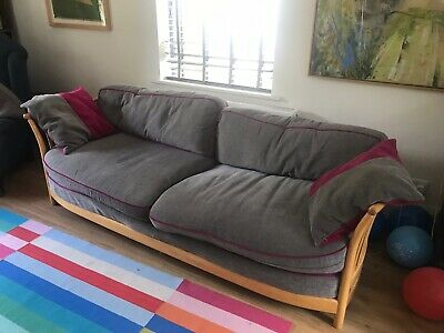 ercol 4 plus large seater sofa, newly upholstered, soft grey, hot pink piping.