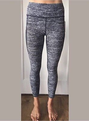 dbfb7548cc Lululemon Size 8 Pace Perfect 7/8 Tight Black White AIRT Mesh Wrap Crop  Wunder