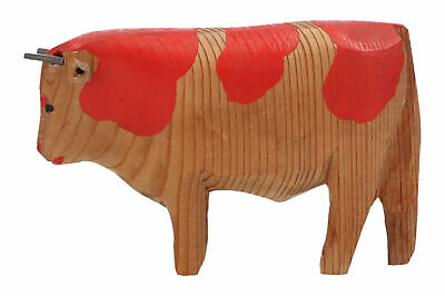 An old hand carved wooden bull toy Vintage