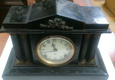 Antique: Ansonia 8 day Iron Decorated Mantle Clock.