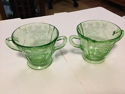 2 green depression glass 2 handle trophy style cups
