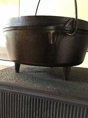 Lodge cast iron three footed #10 seasoned dutch oven and cover with bail