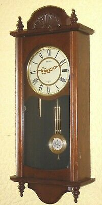Quality vintage wooden quartz movement pendulum wall clock by Seiko, GWO