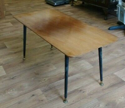 very cool Vintage table, great sleek design, perfect size. original piece!