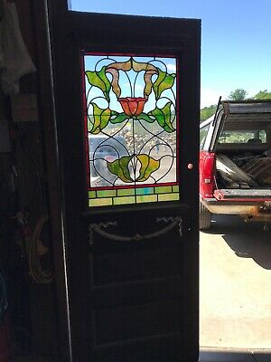 An 553 Antique Stained Glass entrance door 31.75 x 83.5 by 1.5