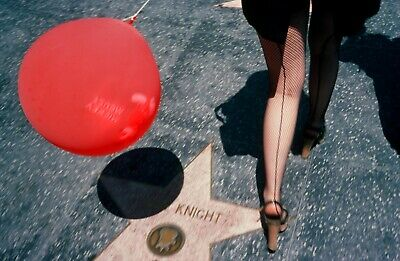 Hollywood Boulvevard: Woman In Net Stockings And Mickey Mouse Balloon. July 1976