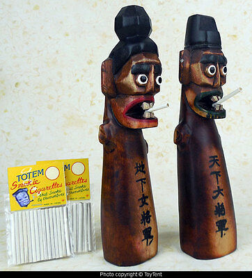 Smoking Totems pair of carved wood figurines with self-smoking cigarettes Japan