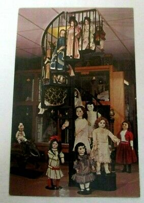 1950s chrome postcard of Staircase with Assortment of  French & German Dolls