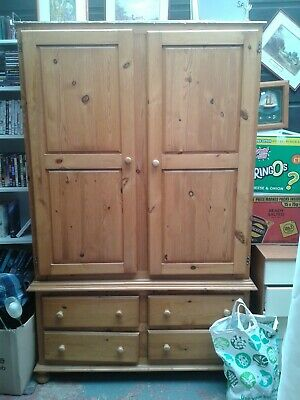 double pine wardrobe with 4 draws needs some tlc but still sturdy low price