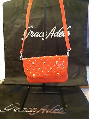 Brand New Grace Adele Elegant Faith Orange Clutch with tags on