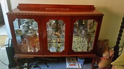 1920's antique china cabinet. Ball and claw feet. Mirrored back and base