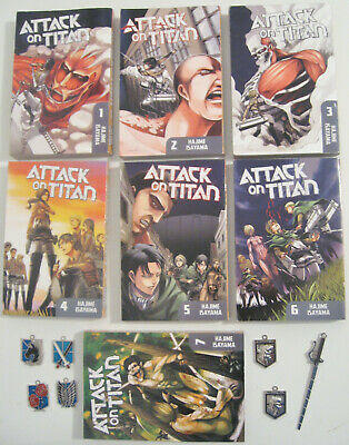 ATTACK ON TITAN Volume 1 to 7 Manga Comic Book plus 7 Metal Emblem Charms bundle