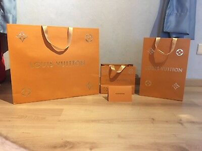 Lots de 4 pieces en papier: Louis Vuitton orange doré