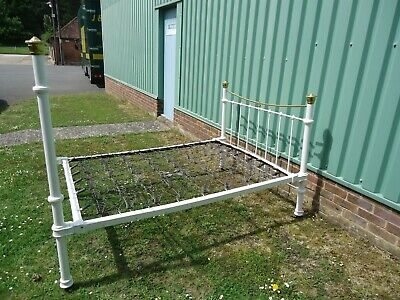 Victorian Cast Iron And Brass Double Bed Frame With Sprung Base On Metal Castors