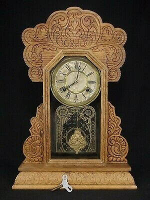 antique gingerbread clock WATERBURY rare oak mantel carved key pendulum ORNATE