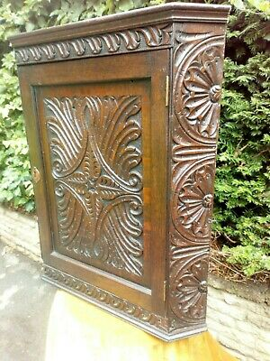 Wonderful hand carved 19th century oak hanging cornier cabinet