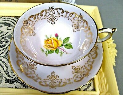 Paragon tea cup and saucer lavender teacup and yellow rose centers gold gilt