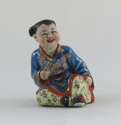 chinese porcelain figure of a seated boy; Republic; 20th century; 9cm