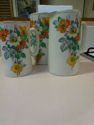 BCM/NELSON set of 3 graduated stoneware PITCHERS.Floral design 1940 s.ENGLAND.
