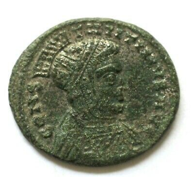 Constantine I Æ AD 319. helmeted, laureate and cuirassed bust right / VICTORIAE