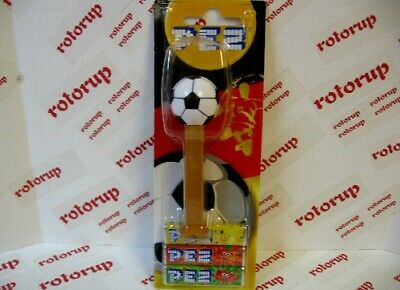 PEZ pair of German Soccer Pez dispensers from a few years ago gold and red stems