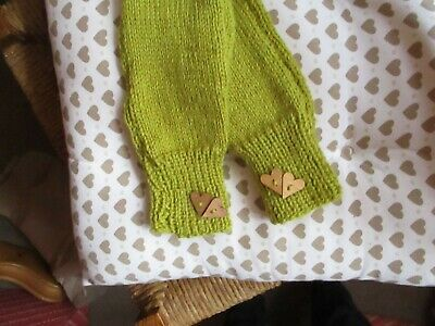 Hand  knitted  fingerless mittens  in  Alpaca  mix  yarn.  with  wooden  hearts