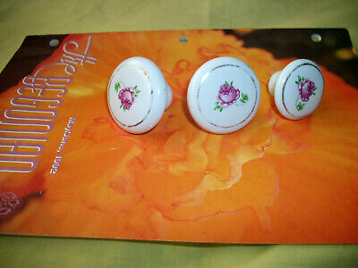 3 Vintage Rose Porcelain Knobs. 2 larger and 1 smaller. Used and still pretty.