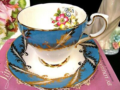Paragon tea cup and saucer baby blue floral teacup gold gilt work footed set