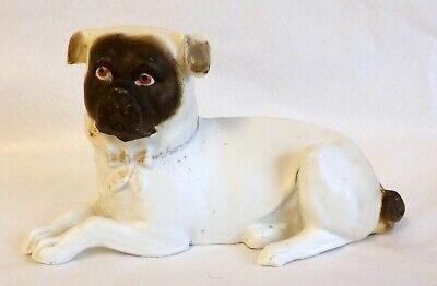 Victorian Bisque Model of a Pug  Lying Down Wearing a  Gold Bow