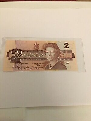 1986 - $2.00 bill. Canadian Paper Money (uncirculated) In Plastic Sleeve
