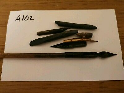 Pen and various nibs etc. From antique writing slope