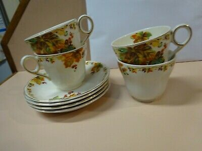 GRINDLEY CREAMPETAL set of 4 matching cups and saucers .Art deco era.
