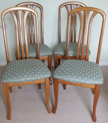 Four Sutcliffe Arran teak dining chairs, upholstered seats