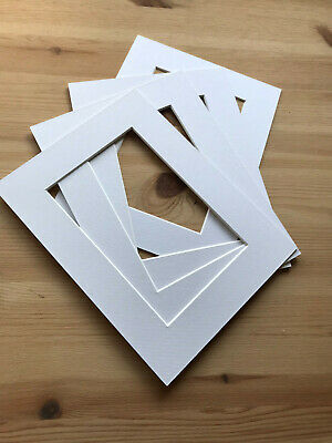 Brand New Pack Of 4 White Picture Frame Mounts Size 20 X 15 Cm To Fit 14 X 9 Cm