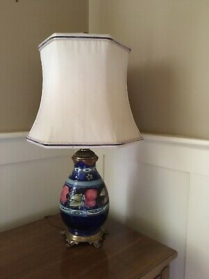 Floral porcelain Moorcroft Lamp, mostly blue in colour, in great condition.