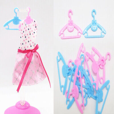 20 X Plastic Pink Hangers For Doll Dress Clothes ACCESSORIES HOT R3R8