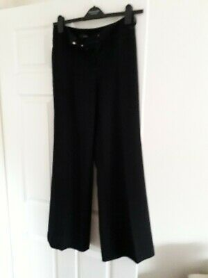 Woman's/Girls NEXT Black Polyester Trousers. Slight Flare. Size 8 R. Used.