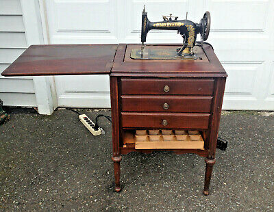 Antique NEW HOME Sewing Machine with Hard Wood Cabinet Works needs minor repairs