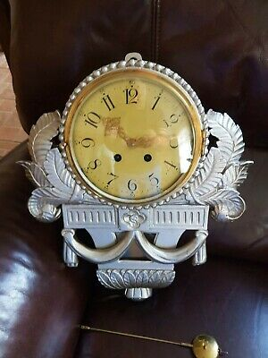 Wood carved cased wall clock