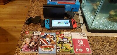 Nintendo Switch Neon Blue and Red Joy Home Console. Plus 4 Games.