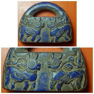 Neareastern intercultural lock weight with  double side cows carved