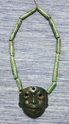 Pre-Columbian Olmec Stone mask with Maya imperial jade necklace from Mexico. Ca.