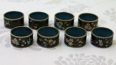 Set of 8 Chinese Serviette / ring holder, 50 mm width, flower design.