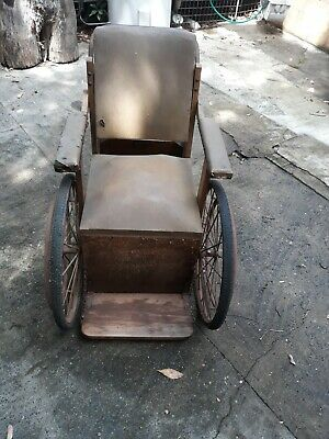 Vintage wheelchair. Brand and age unknown. Suit restoration or movie prop.