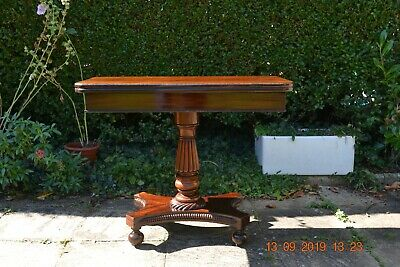 A well used William fourth / Victorian fold over card table.